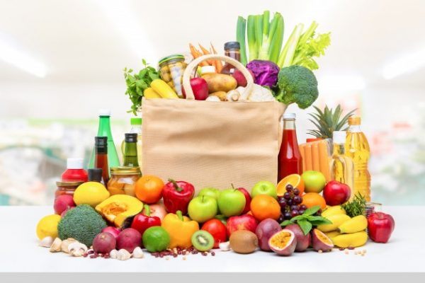 colorful-food-groceries-white-countertop_8087-2209